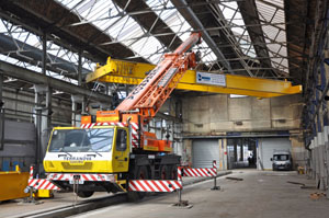 The first of two new 30T gantry cranes is lifted into position in Bay 1