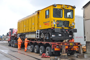 Stored Rail Grinder DR79265 is loaded onto a lorry for the trip to York